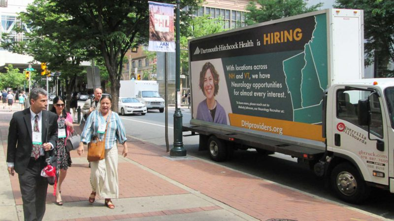 Mobile billboard truck in Philadelphia featuring a now hiring ad.