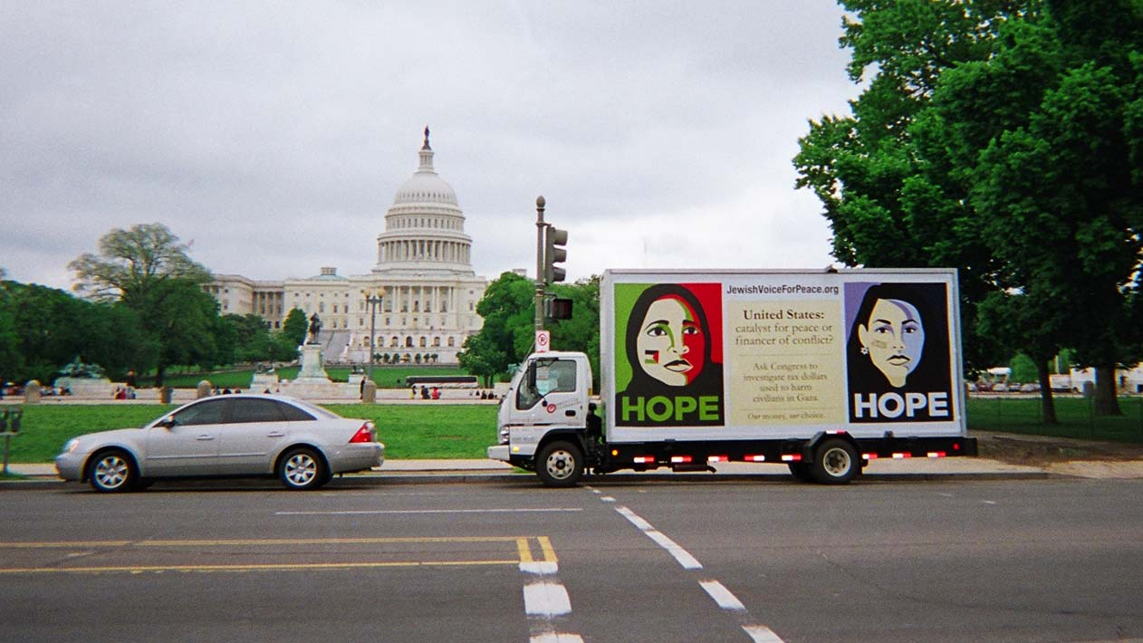 Mobile billboard truck stopped across from the U.S. Capitol in Washington DC.