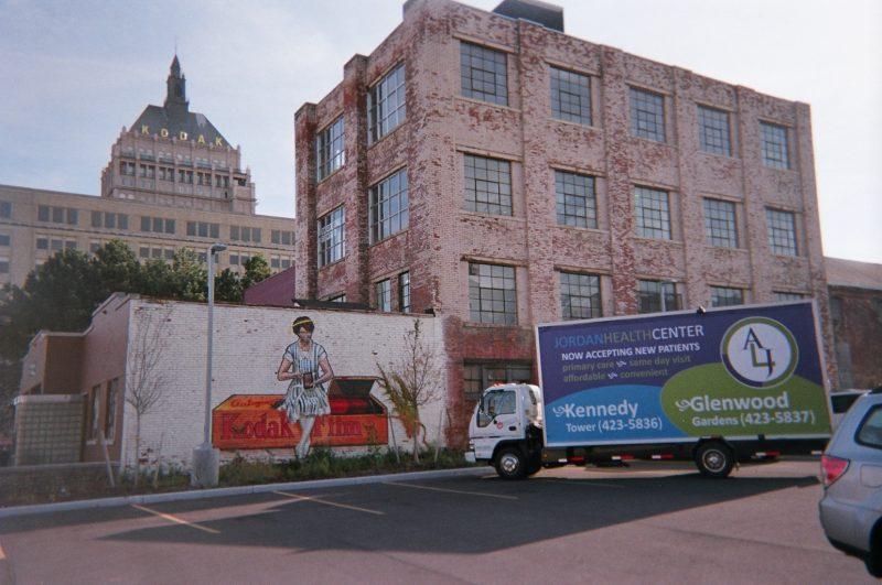 Billboard truck in Rochester NY at iconic handpainted billboard advertising Kodak Film