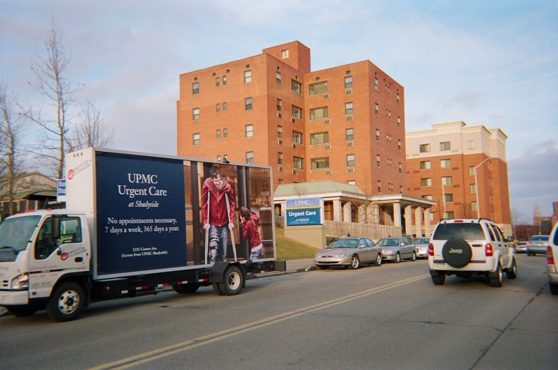 Billboard truck promoting urgent care center opening in Pittsburgh PA