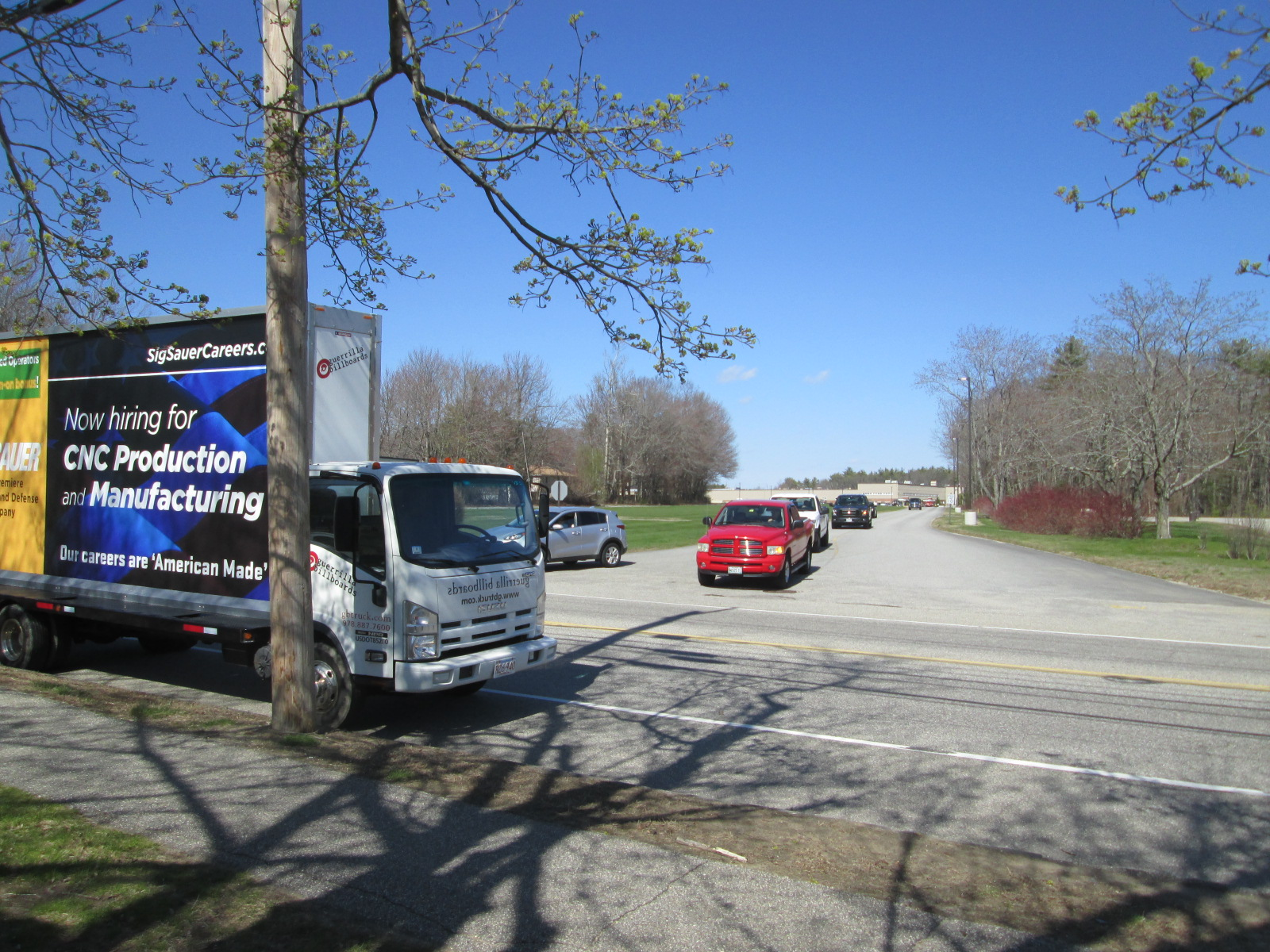 Employee recuiting billboard truck ad with shift change traffic in Southern Maine