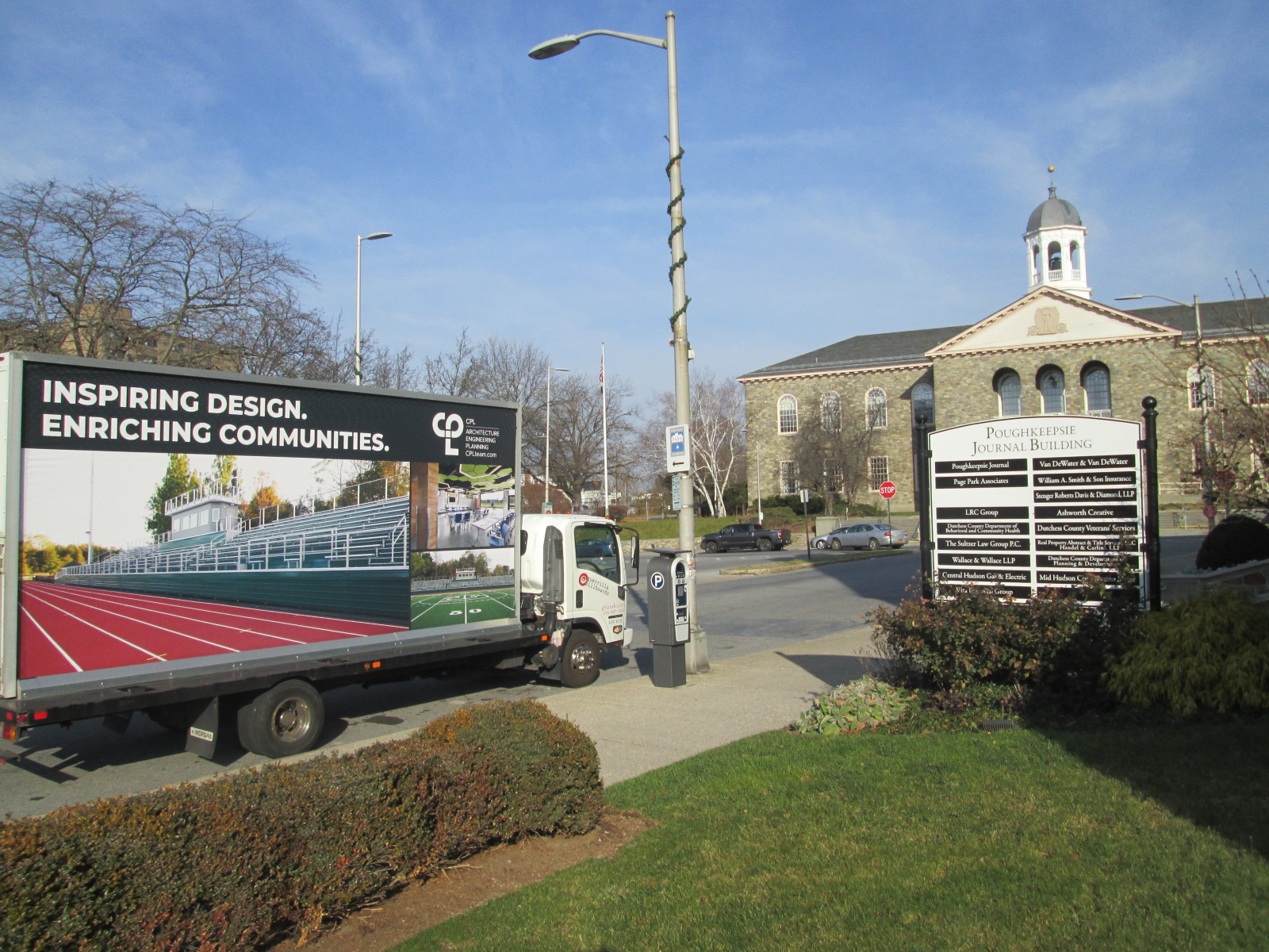 Mobile billboard stopped at the Poughkeepsie Journal Building in Poughkeepsie NY