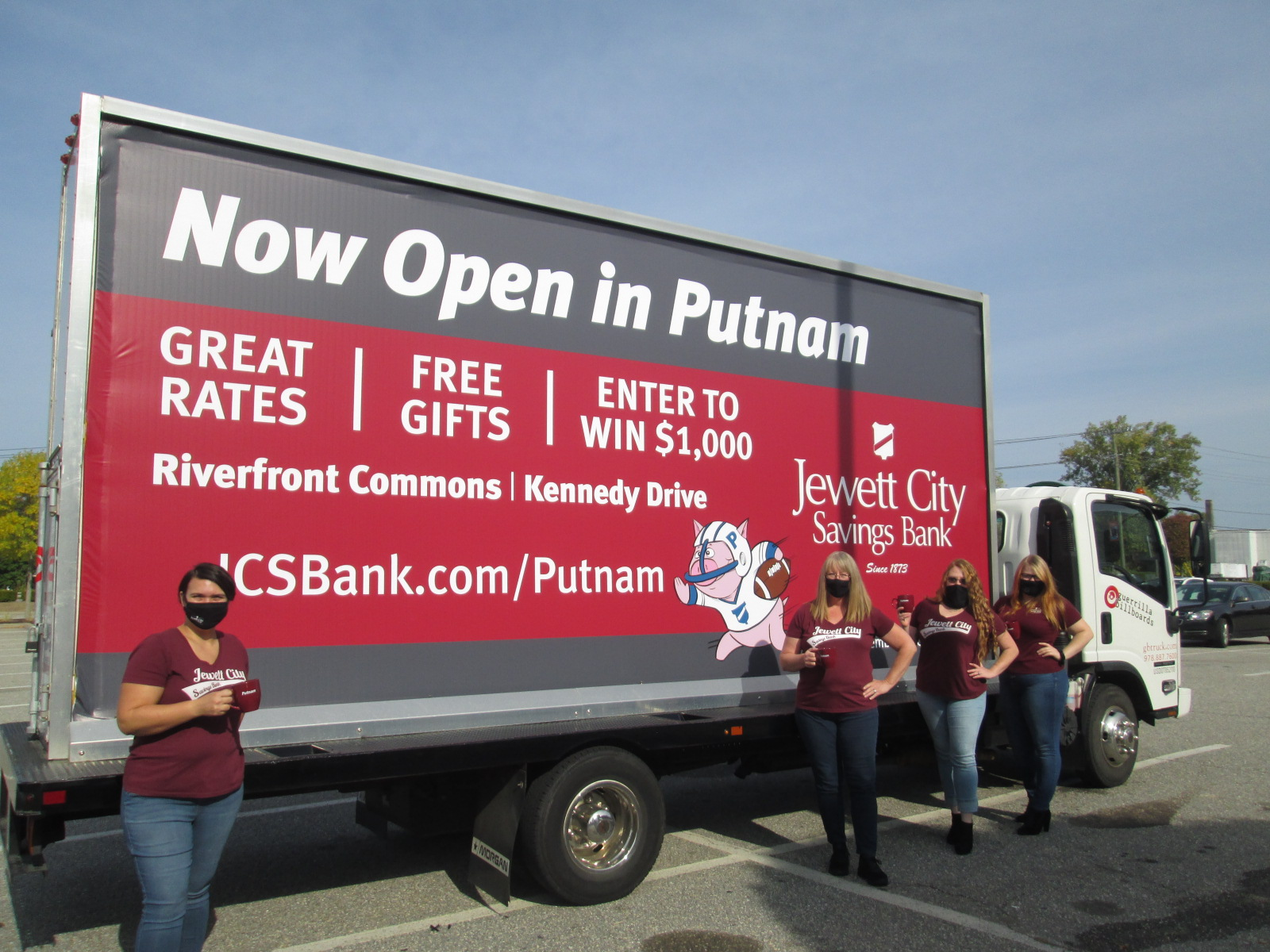 Mobile billboard promoting a new bank branch in CT.