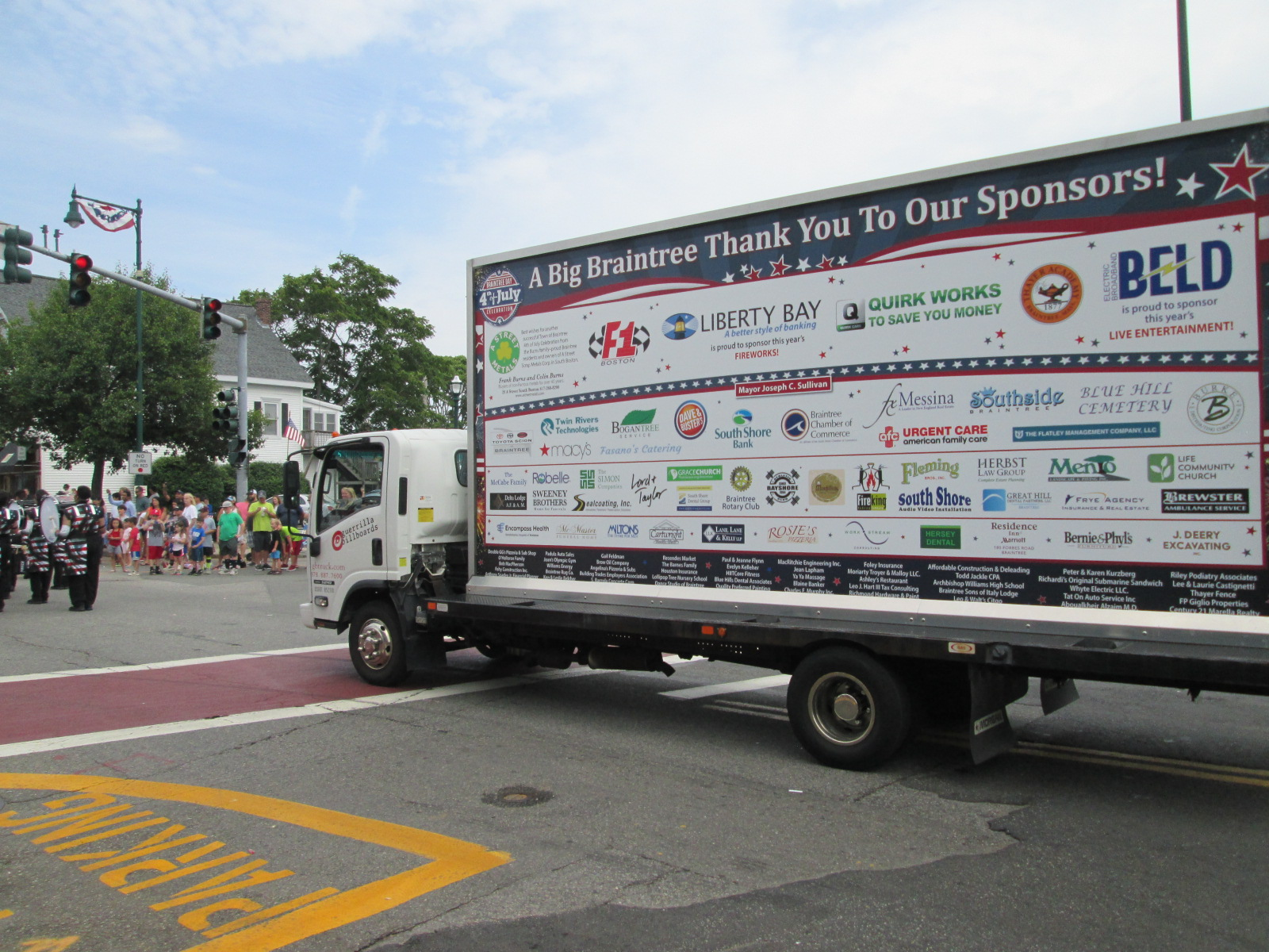Billboard truck running in a parade with a Thank You Sponsors ad