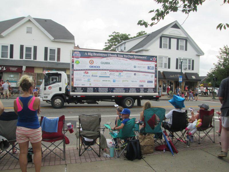 Billboard truck ad thanking 2021 parade sponsors