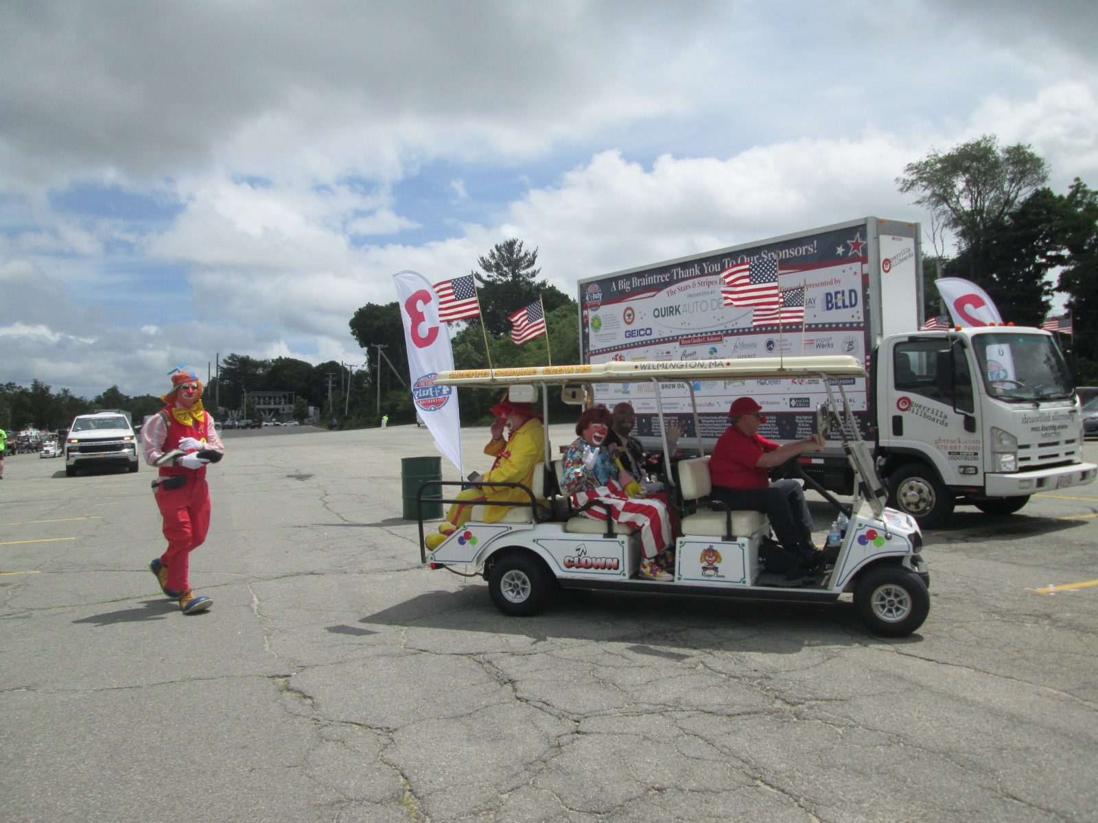 Billboard truck and Shriners Clowns at 2021 Braintree July 4th Parade staging area