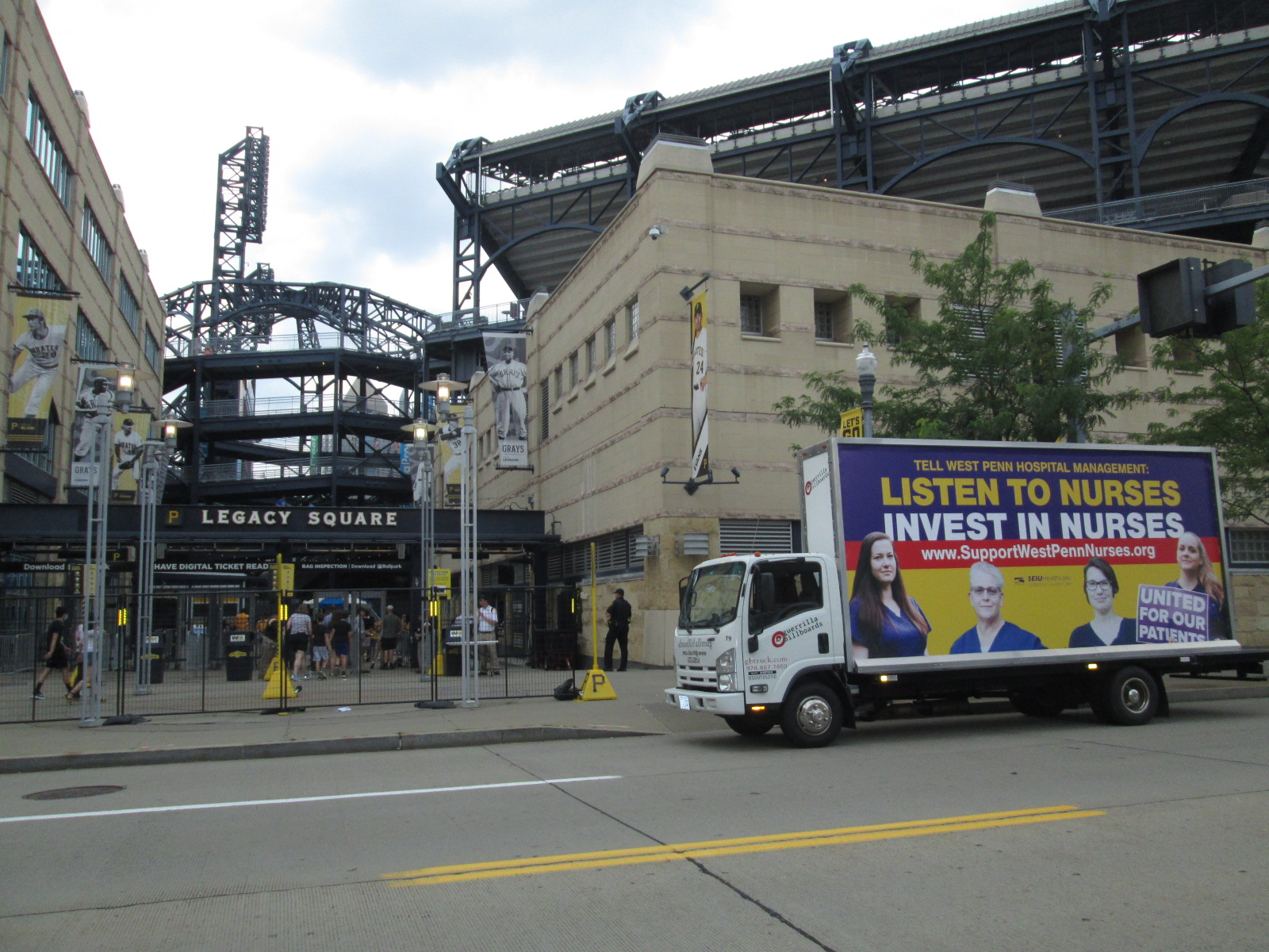 Mobile billboard truck passing PNC Park in Pittsburgh